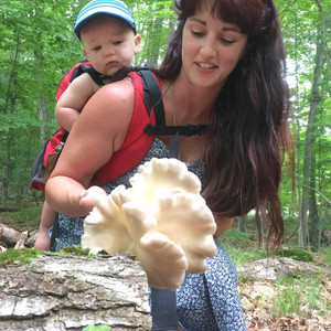 mom and baby picking mushrooms