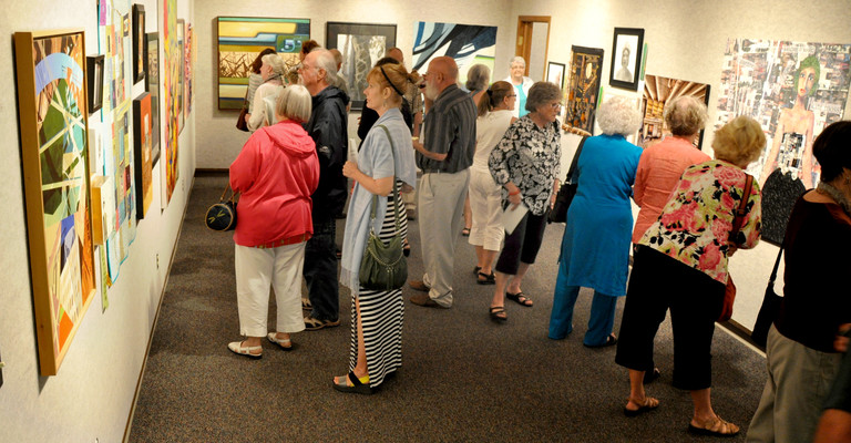 people viewing art in the nicolet art gallery
