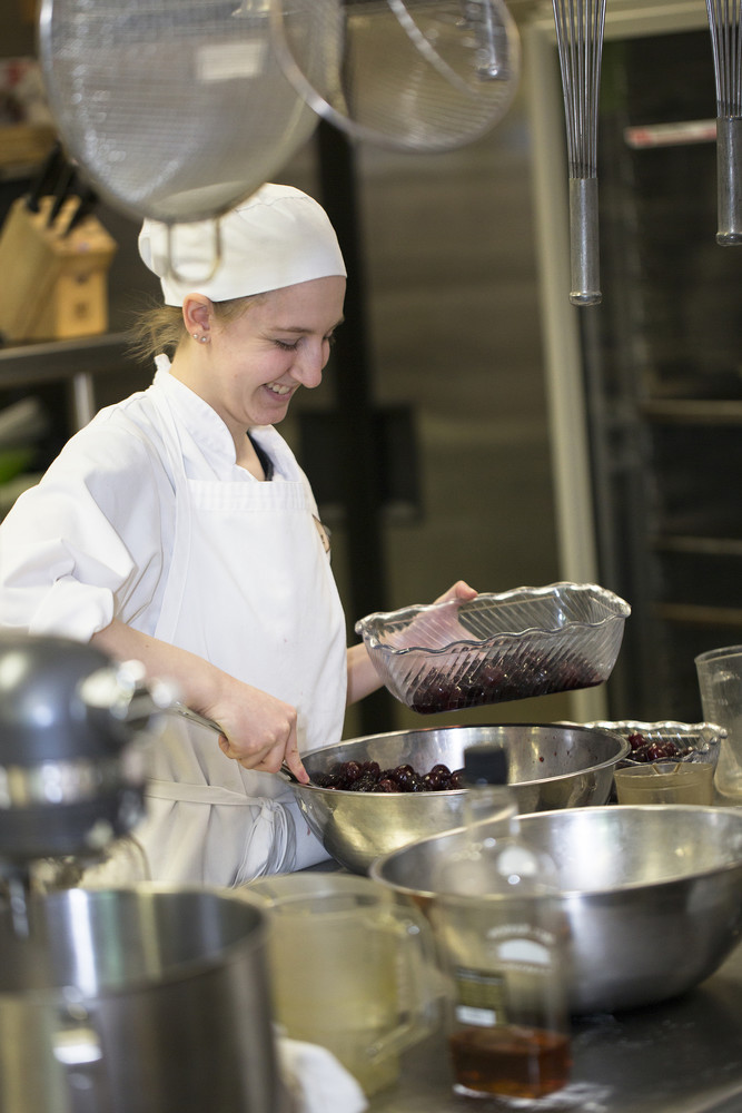 student chef mixing cherries in a bowl