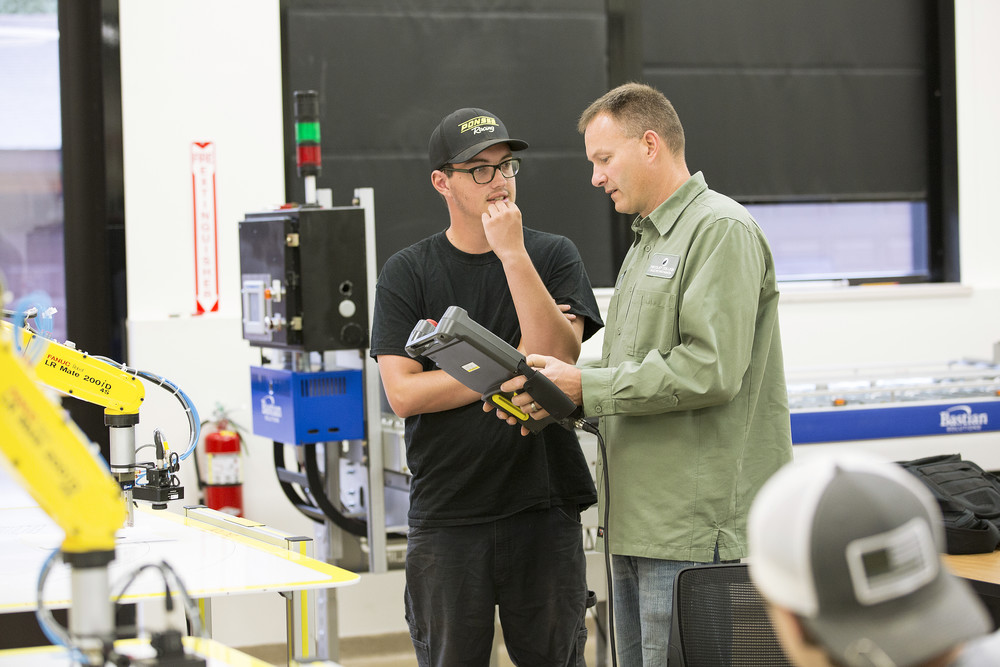 Electromechanical student talking with instructor