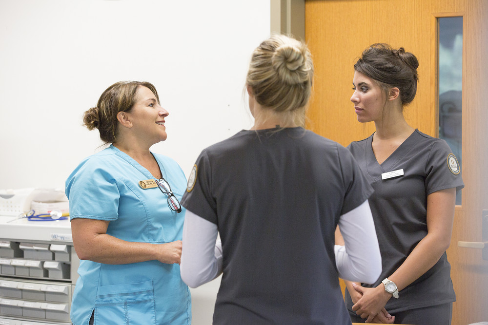 nursing instructor talking with students