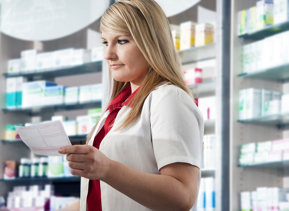 Pharmacy services manager reading prescription