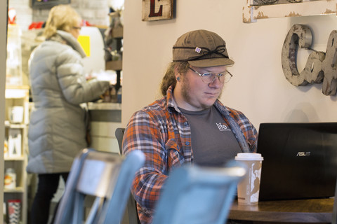 online learner at local coffee shop