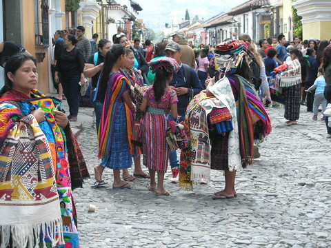 women and children in Guatemala in hand woven clothing